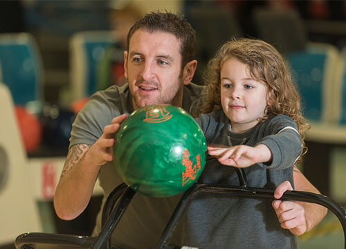 Dad & little girl bowling at Guildford Spectrum